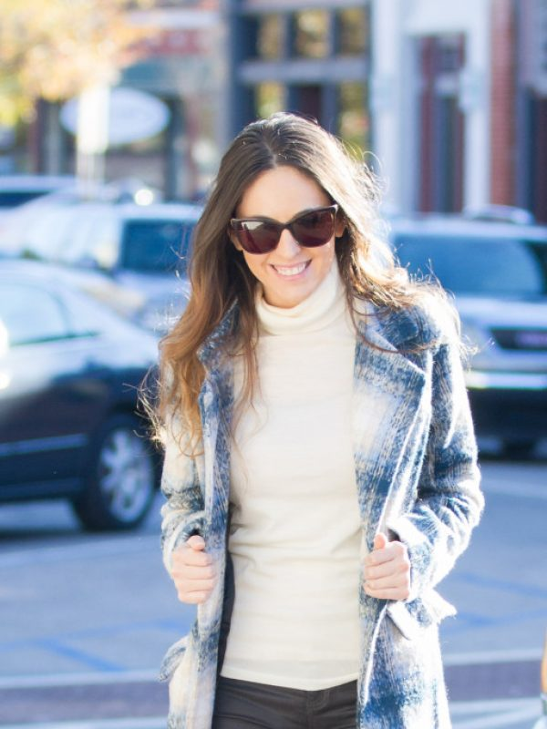 classic check coat, winter style, ivory turtleneck, wax-coated jeans