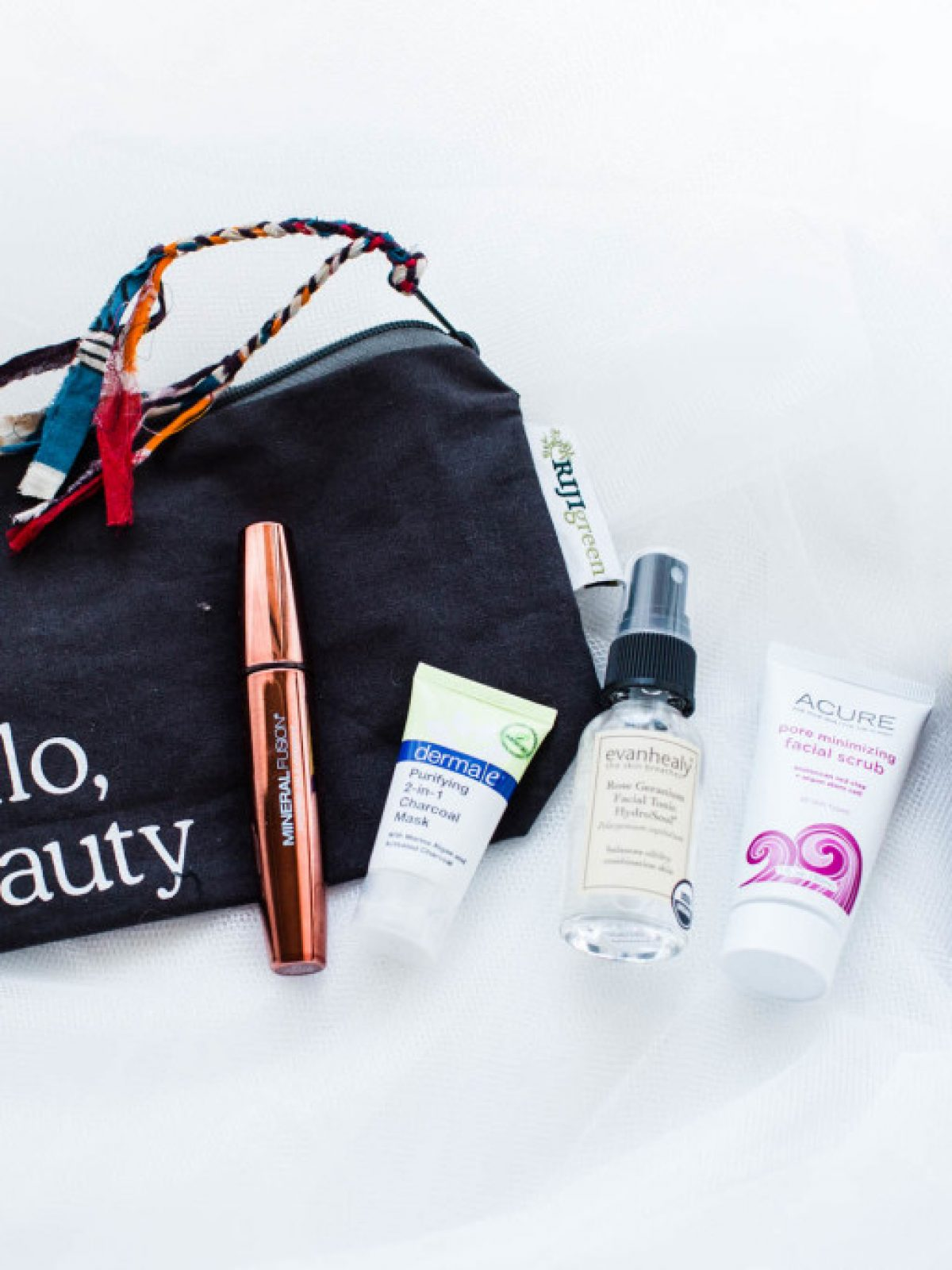 whole foods beauty bag, clean beauty favorites, dermae Purifying 2-in-1 Charcoal Mask, Acure Pore Minimizing Facial Scrub, Burt's Bees Sunset Cruise Lip Stick