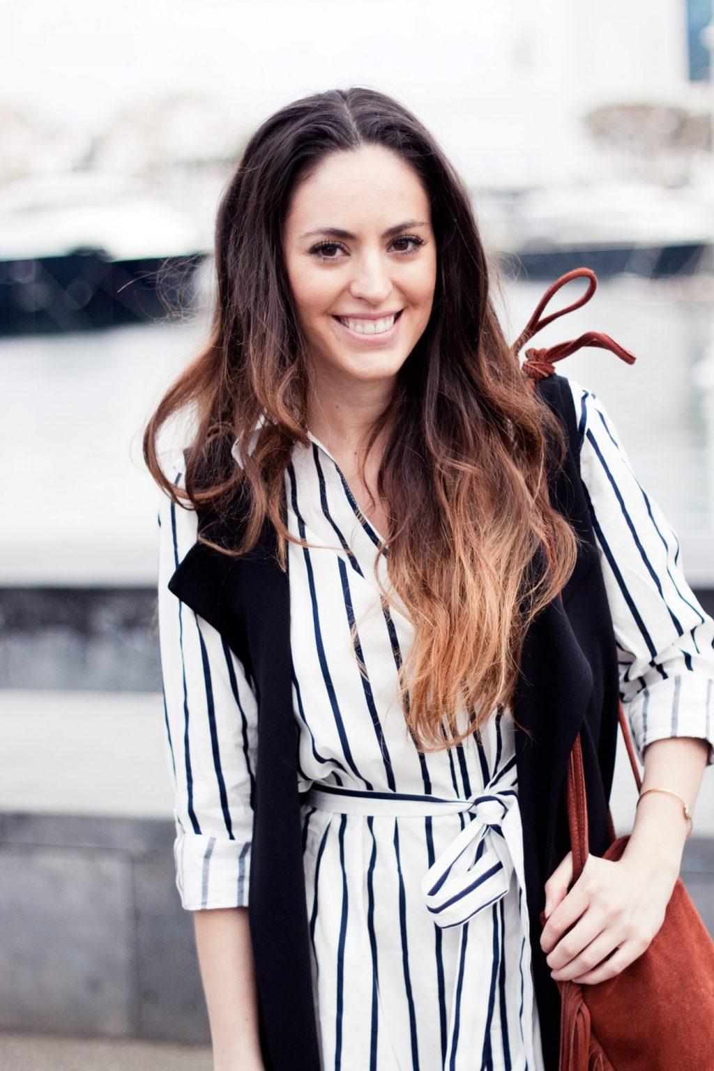 barcelona spain, barcelona, shopbop, long black vest, how to wear a long vest, striped dress, shopbop, fringe bucket bag, fringe crossbody, what to wear in barcelona, barcelona port