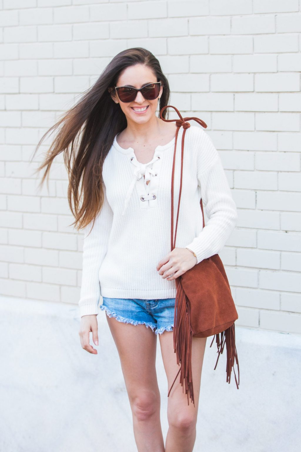 Sweater and shorts, spring style, spring outfit ideas, lace up sweater, how to wear a sweater with shorts, fringe crossbody bag, spring in the south, southern spring style