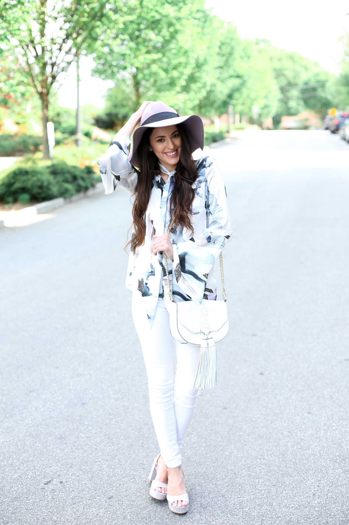 spring style, 70s vibes, 60s glam, 70s glam, spring chic, how to style a hat for spring, chinese laundry theresa smoke grey, purple floppy hat, wide brim fedora, wide brim hat, rebecca minkoff fringe crossbody