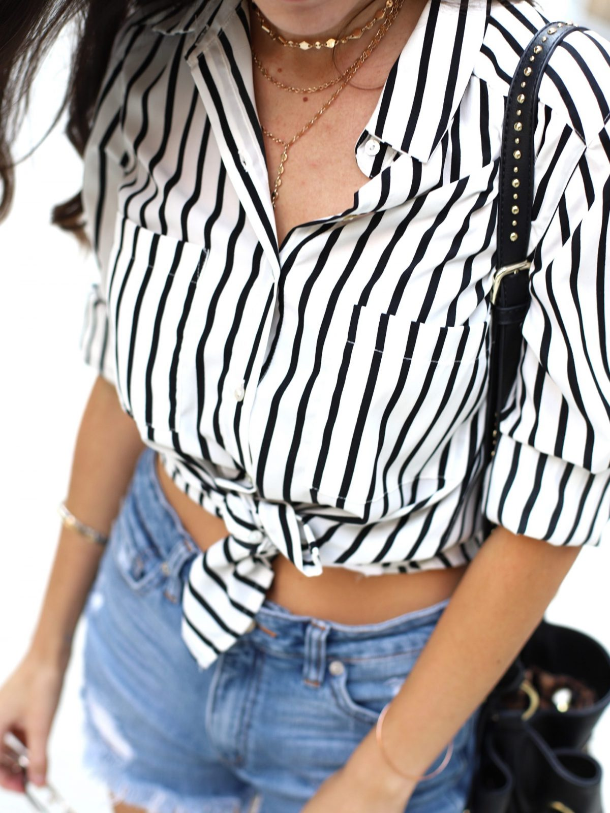 striped button down, how to wear a button down with cutoffs, stripes in summer, summer stripes, summer city style, urban style, summer outfit ideas, casual summer style, kaanas Belem Orange, round sunglasses, black bucket bag