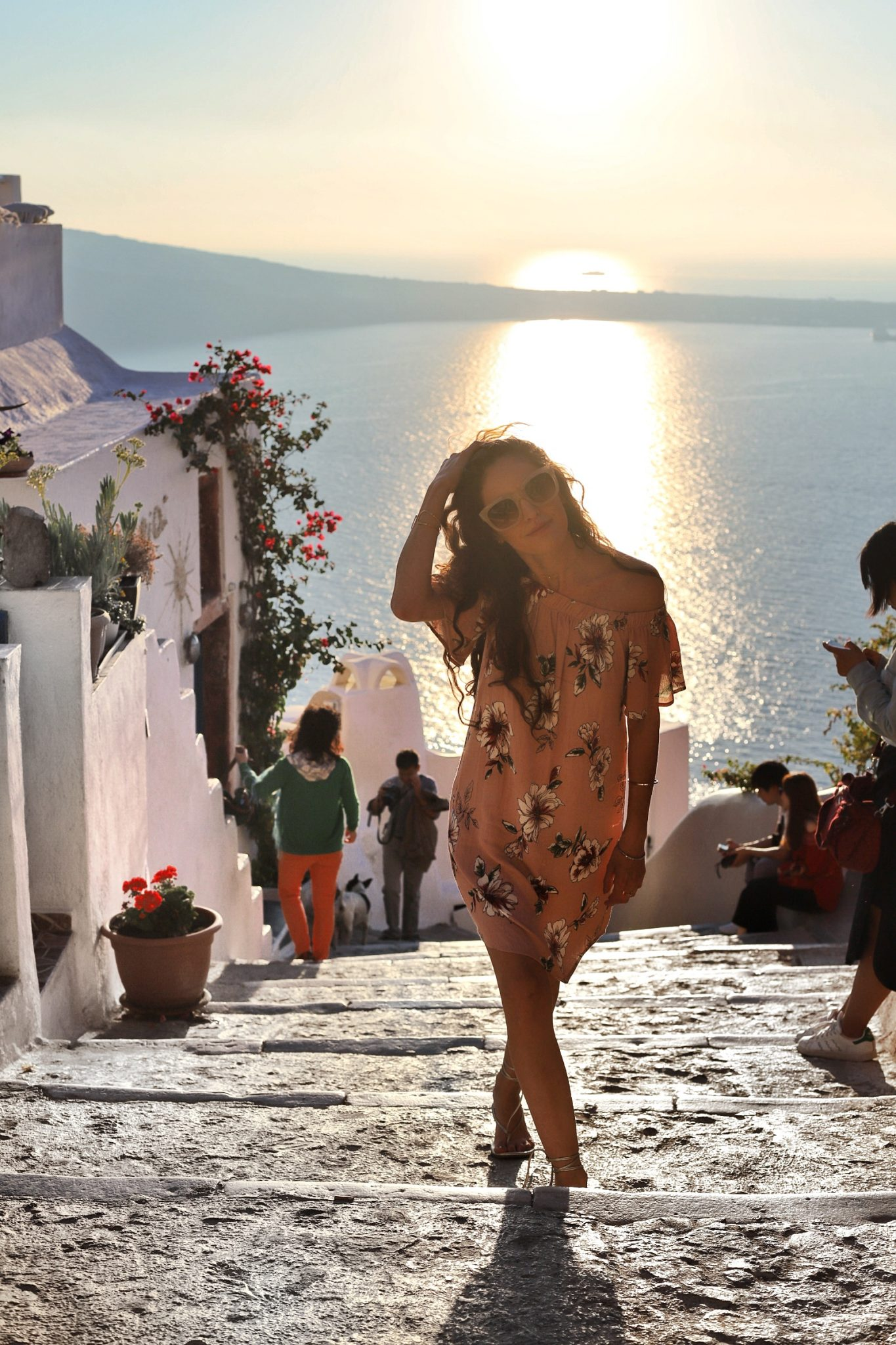 santorini sunset, sunset in oia, where to watch the sunset in Santorini, pink off the shoulder dress, charming charlie EVERLY FLORAL OFF-THE-SHOULDER DRESS