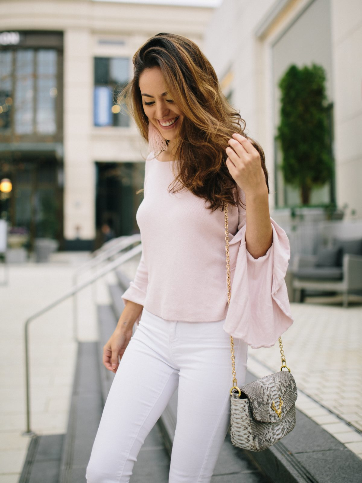 light pink in winter, wearing white in winter, light pink and white, bell sleeve sweater, feather earrings, snakeskin bag, taxidermy handbags, wearing light colors in winter