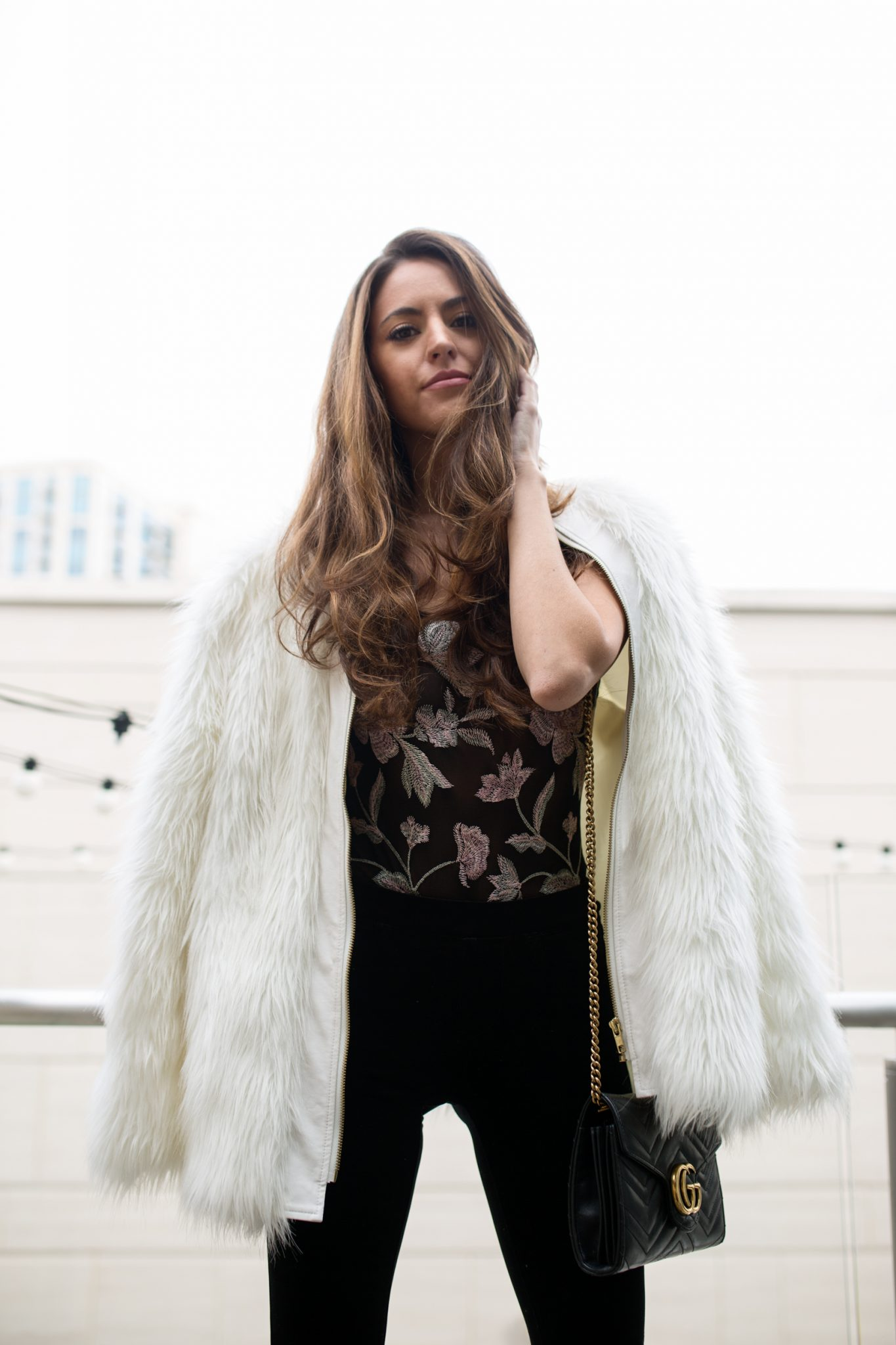 NYE outfit inspo, what to wear on new years eve 2017, NYE 2018, New Years 2018, retro chic NYE look, Blank NYC black velvet flares, express floral bodysuit, white fur coat, Atlanta style bloggers