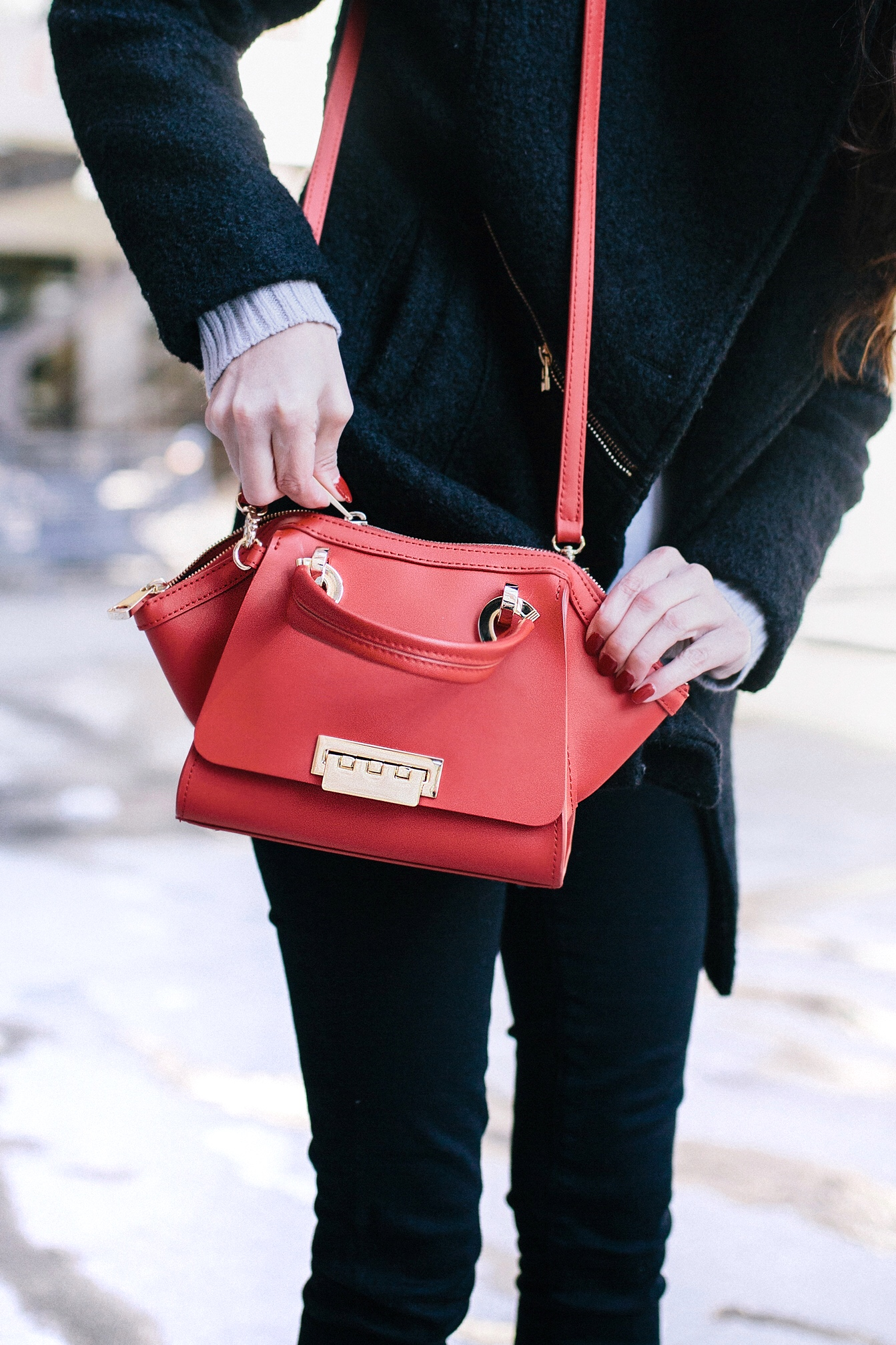 red accents, winter style, layered sweater, shopbop on amazon, zac zac posen women's eartha iconic mini double handle bag in geranium, bauble bar Rosabella Tassel Earrings red, agolde black skinny jeans