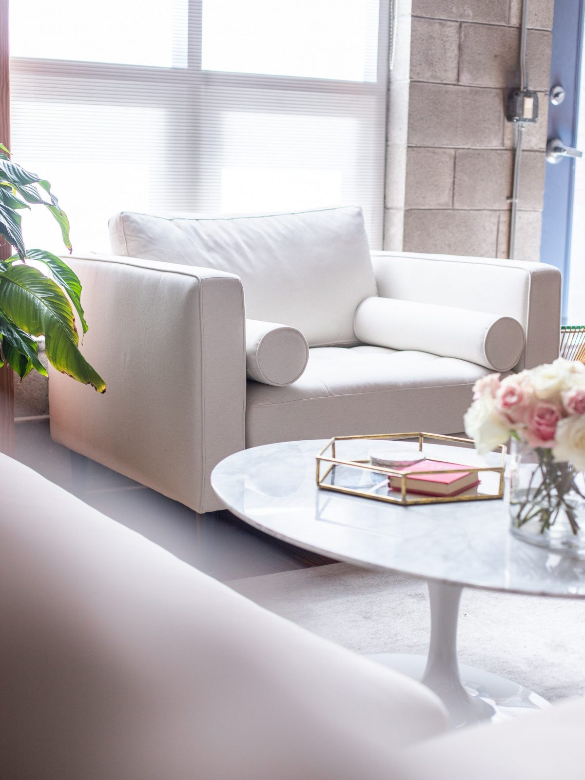 living room makeover, living room reveal, blush pink couch, rove concepts hugo sectional pink, rove concepts luca chairs white, rove concepts marble coffee table, rove concepts petal side table, rove concepts coupon code, rove concepts reviews, feminine living room style
