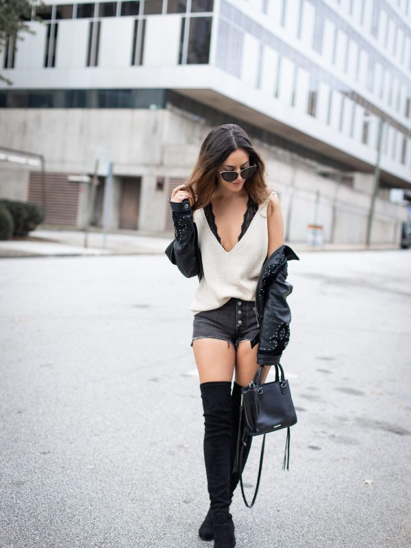 edgy city outfit ideas, how to wear otk boots, otk boots with shorts, how to wear over the knee boots with shorts, fall outfit ideas, fall style, studded faux leather jacket, Levi's 501 Shorts in black eye, aria rose styled, steve madden over the knee boots black