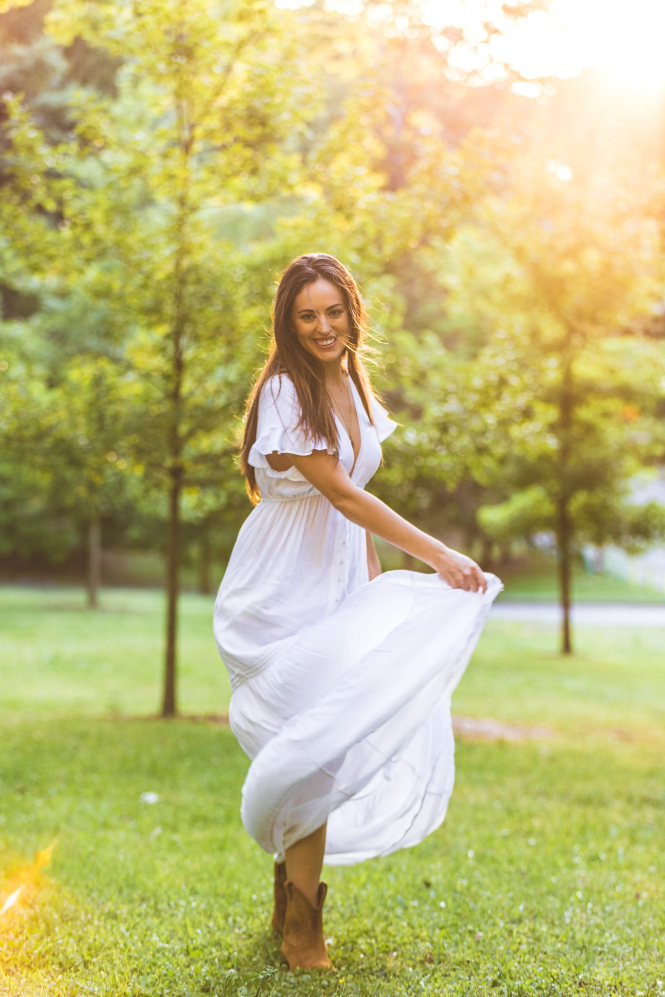 white boho maxi dress with western boots