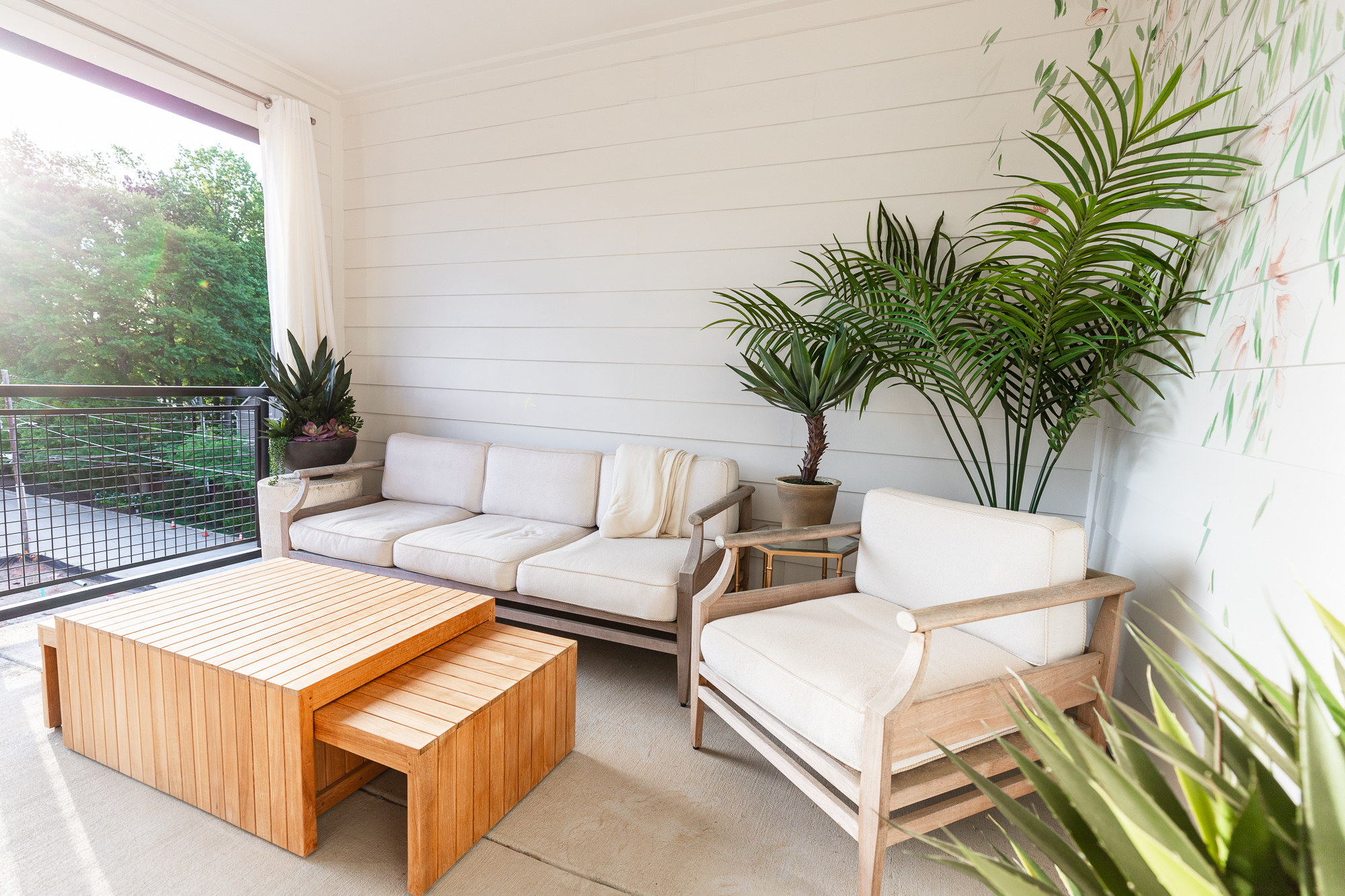 bringing a space to life with faux plants, the perks of faux plants, how to use faux plants in home decor, frontgate faux plants, styled faux plants